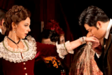 Yosep Kang as Alfredo Dumont kissing the hand of Soprano Corrine Winters as Violetta. Scene from La Traviata.