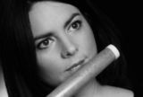 Dark Haired female flautist